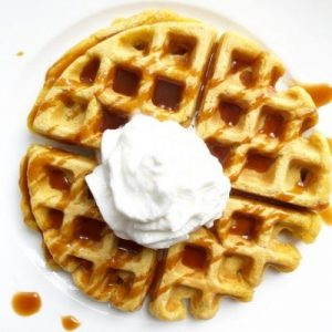 Caramel Syrup over waffles with whipped cream