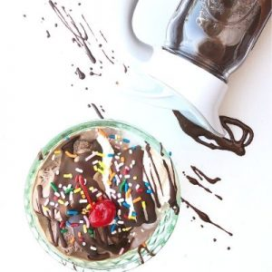 Ice cream in a dish with chocolate shell and sprinkles and an Ergo Spout