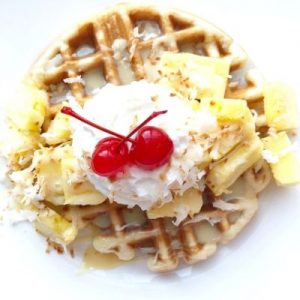 Coconut Syrup over waffle with pineapple, whipped cream and cherries