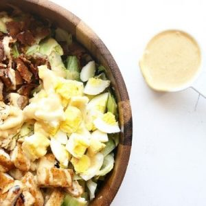 Green salad with eggs, bacon and chicken
