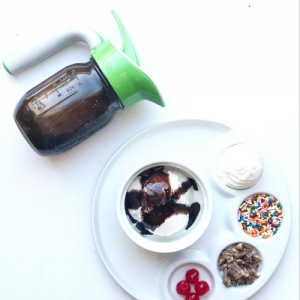 Chcoloate Hazelnut sauce in a mason jar with and Ergo Spout and a bowl of ice cream