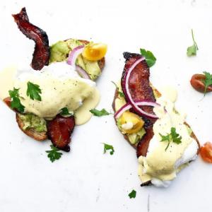 Hollandaise Sauce over eggs with bacon