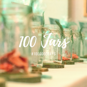 Empty mason jars in a row with a the title 100 Jars #100GoodDays