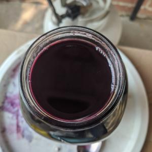 concord grape juice in a mason jar